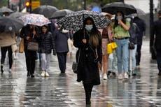 UK weather warning – live: Dozens of flood alerts issued in England as torrential rain ends heatwave