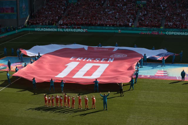 A giant jersey of Denmark's midfielder Christian Eriksen is put on display on the pitch before the Euro 2020 Group B match between Denmark and Belgium at the Parken Stadium in Copenhagen