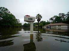 Photos show neighbourhoods swamped by tropical storm Claudette on Gulf Coast