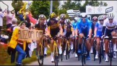 Tour de France crash: Grinning fan wipes out most of peloton on stage 1 with cardboard sign
