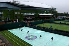 Wet weather delays start at Wimbledon as fans return