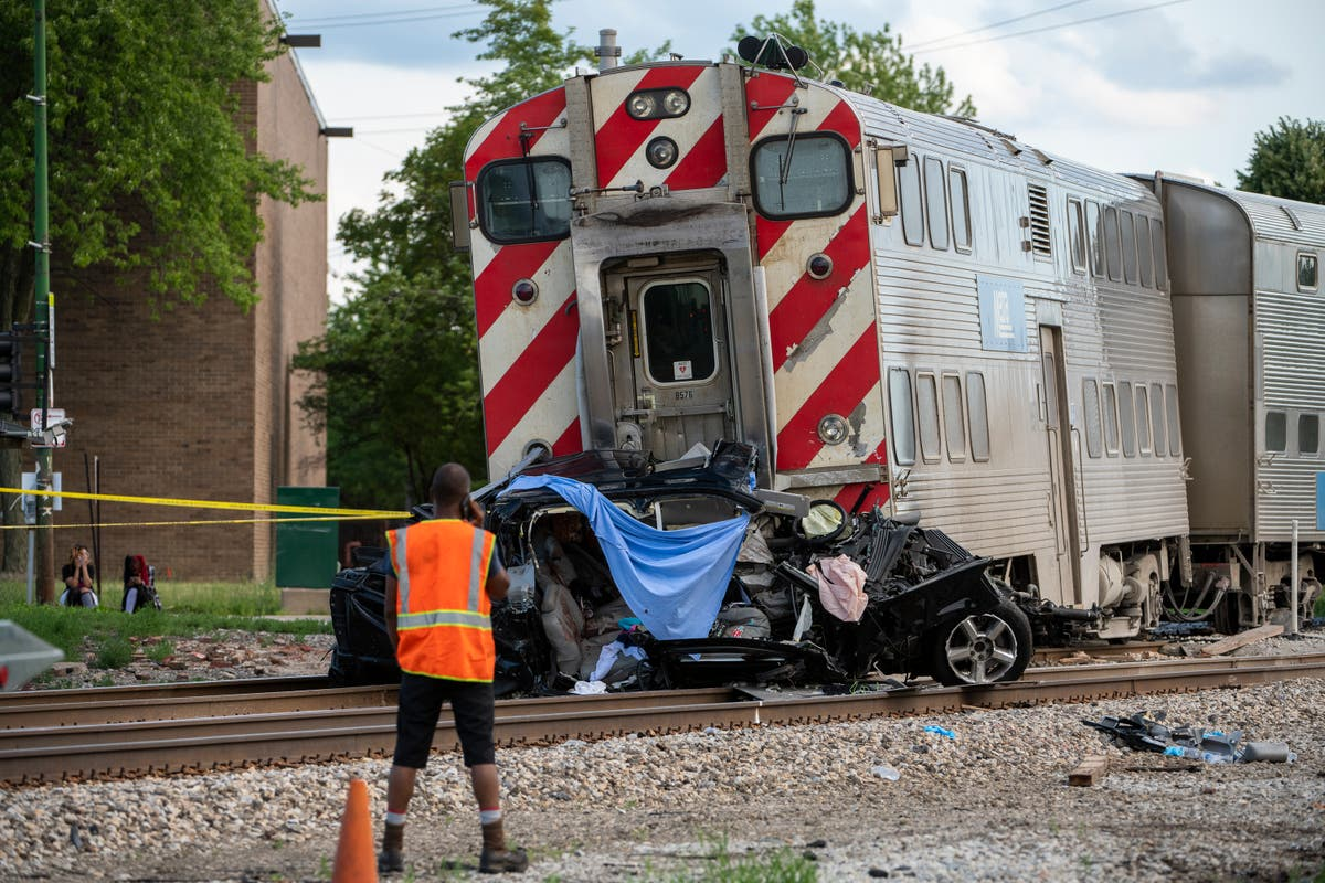 Witnesses: Car struck by train in Chicago drove past gates