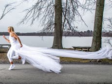Woman runs almost 300 miles in wedding dress to raise money for domestic abuse victims