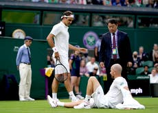 Roger Federer survives major scare as injury forces Adrian Mannarino to retire