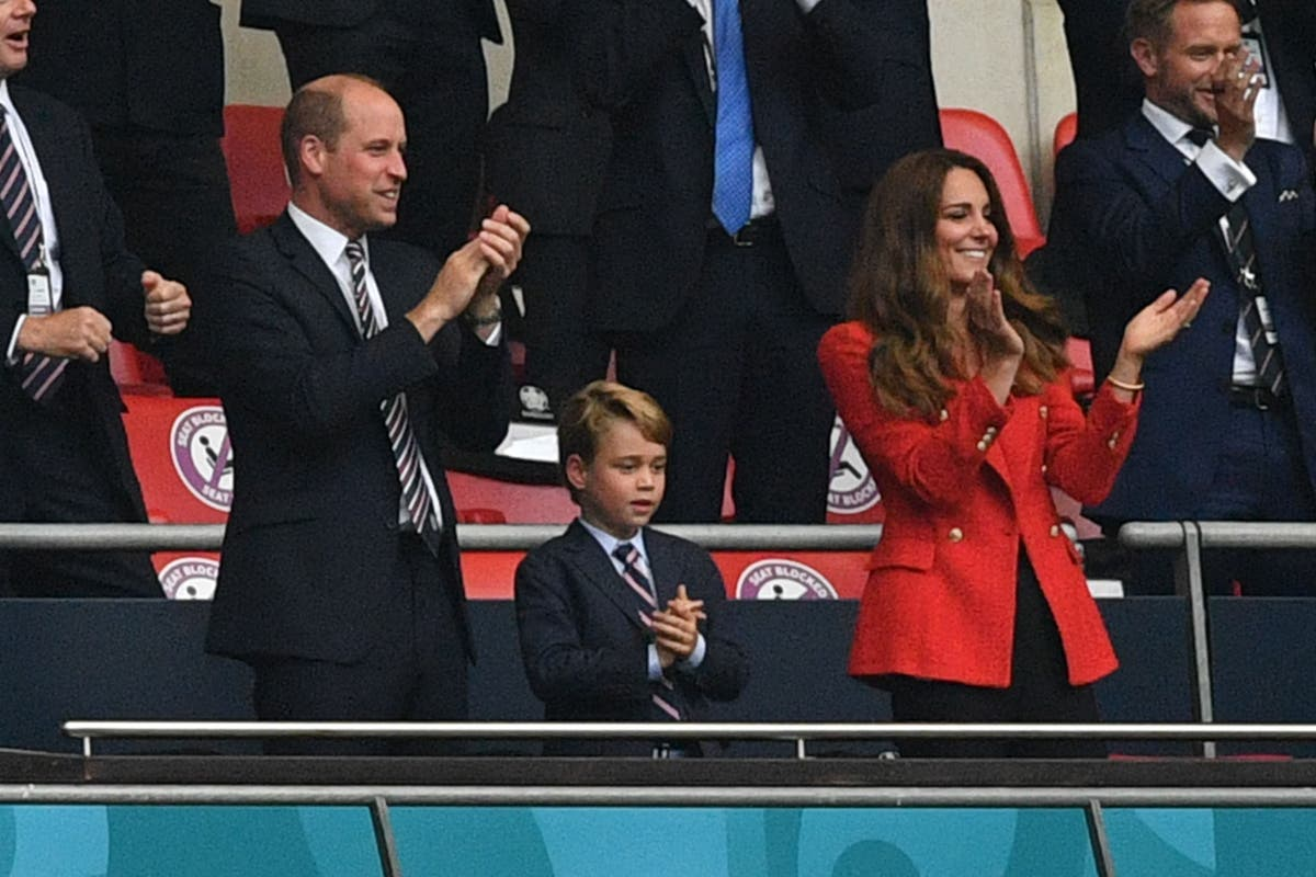 Why is Prince George dressed in a suit? Let the future king wear three lions