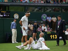 Roger Federer through to Wimbledon second round as Adrian Mannarino retires with injury