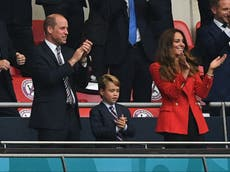 Prince George, 7, wears a suit to attend England football game alongside his parents