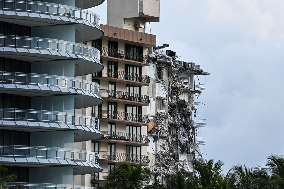 Firefighters offer cat food to missing pets trapped alive in the Miami condo collapse rubble