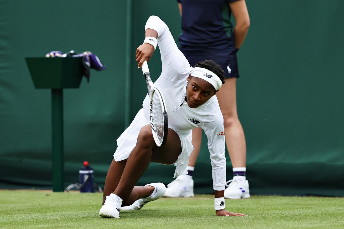 Why are players slipping over at Wimbledon?