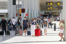 Travel news – live: Spain's tighter entry rules for unvaccinated tourists come into effect