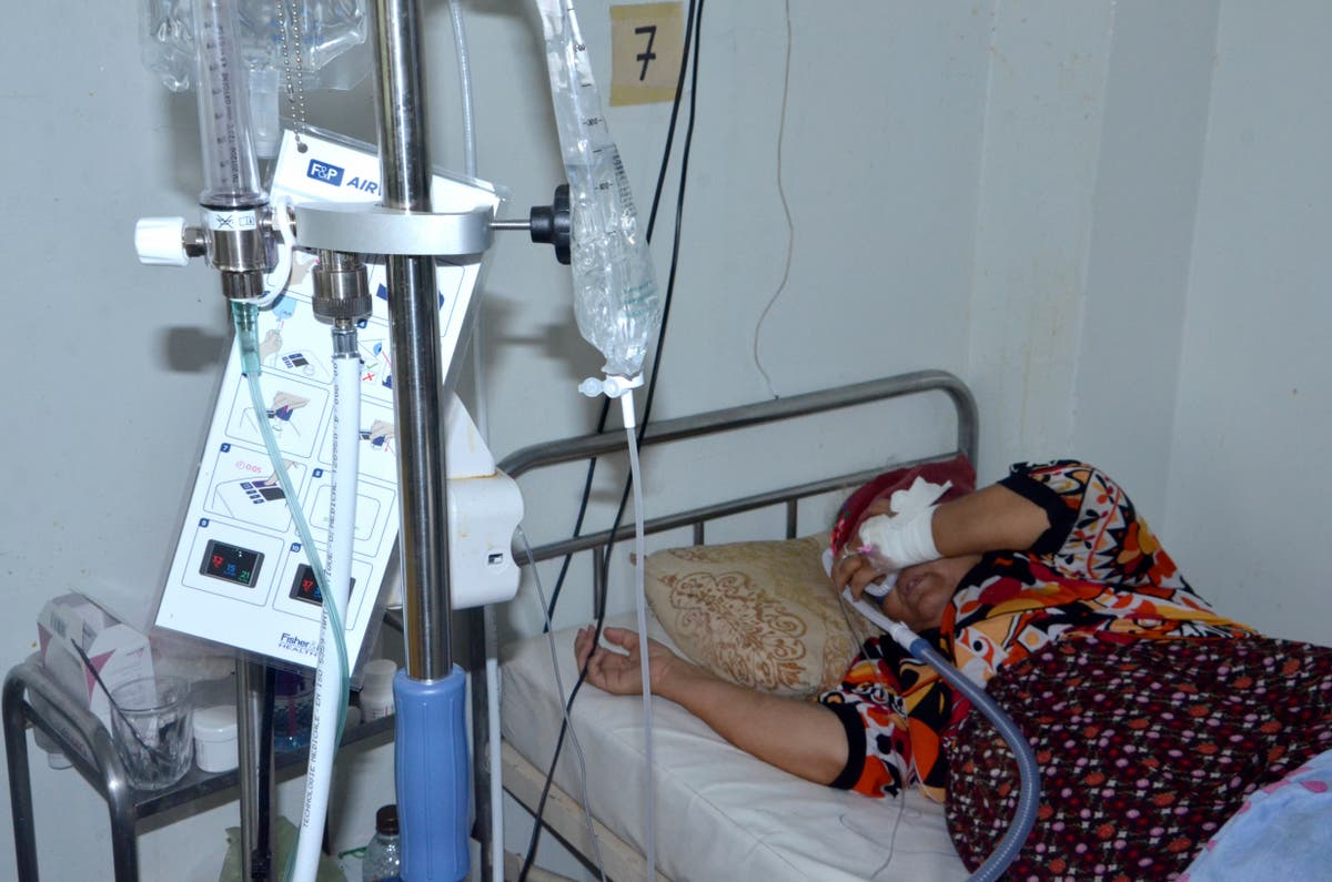 Understaffed Tunisian hospital battles coronavirus spike