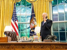 QAnon spreads Biden photo online claiming it shows Trump is secretly in the White House