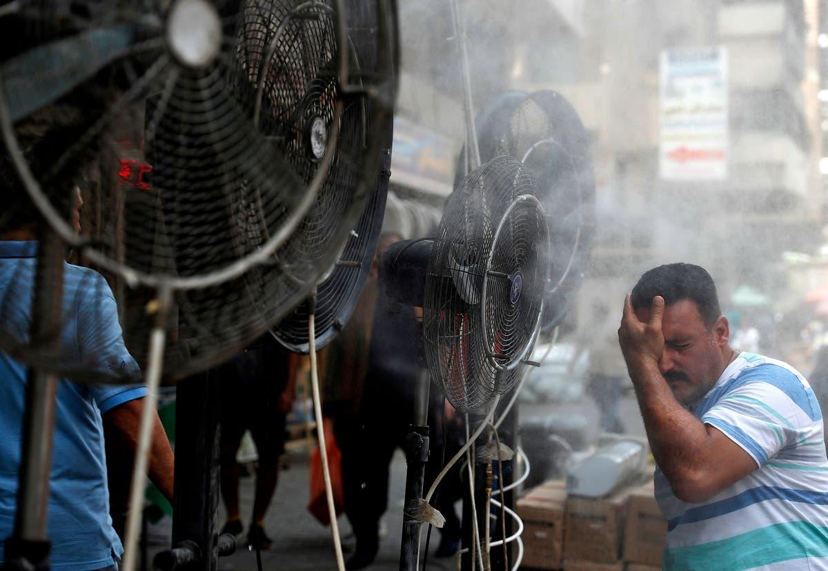 Iraqis  battle in 50C heat  as Iran halts power supply due to unpaid bills