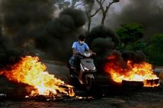 Gunmen take to streets in Lebanese city over economic crisis