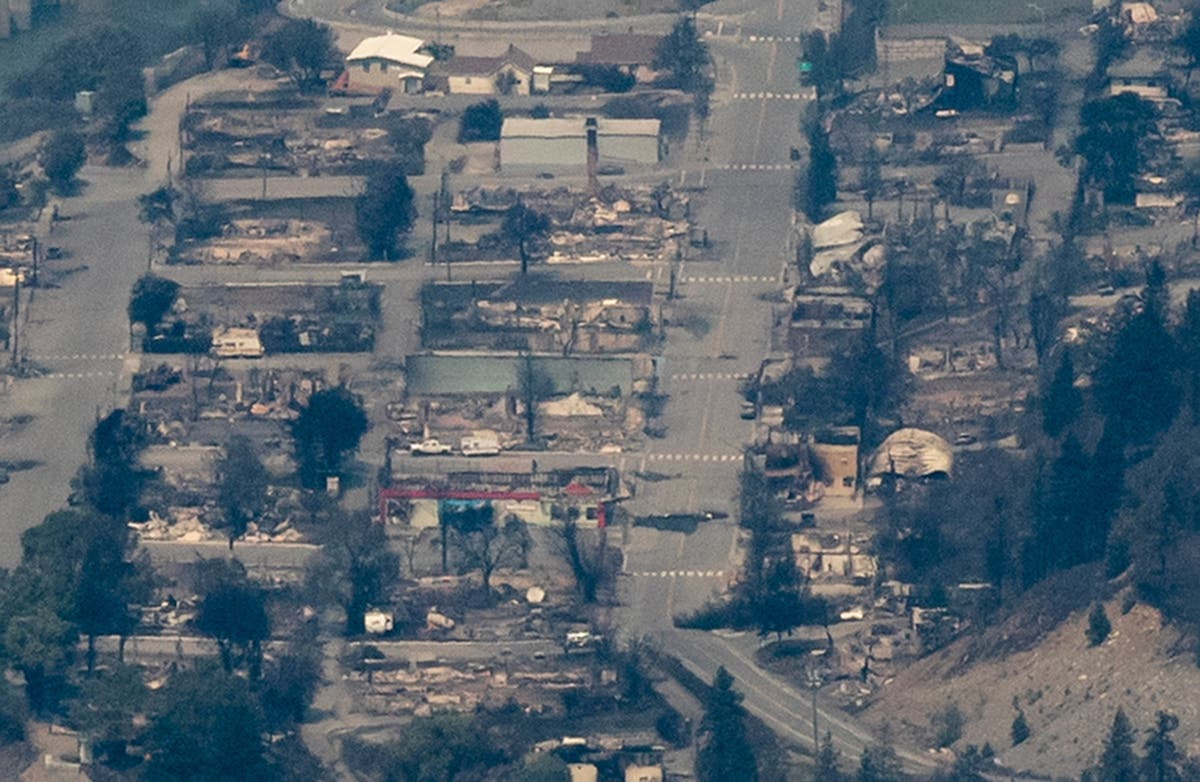 Shocking aerial photos reveal 'warzone-like' destruction in Canada's hottest town after wildfire sparked by a train