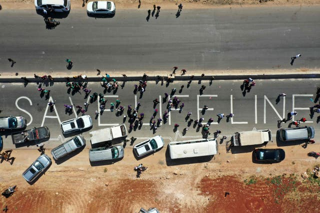 A human chain is formed by workers from the civil society, humanitarian aid, and medical and rescue services in a vigil calling for maintaining a UN resolution authorising the passage of humanitarian aid into Syria's rebel-held northwestern province of Idlib through the Bab al-Hawa border crossing with Turkey