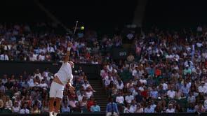Dan Evans serves against Sebastian Korda during their men's singles third round match at Wimbledon