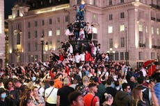 Hundreds climb memorial fountain in London as England fans flood streets after Ukraine victory