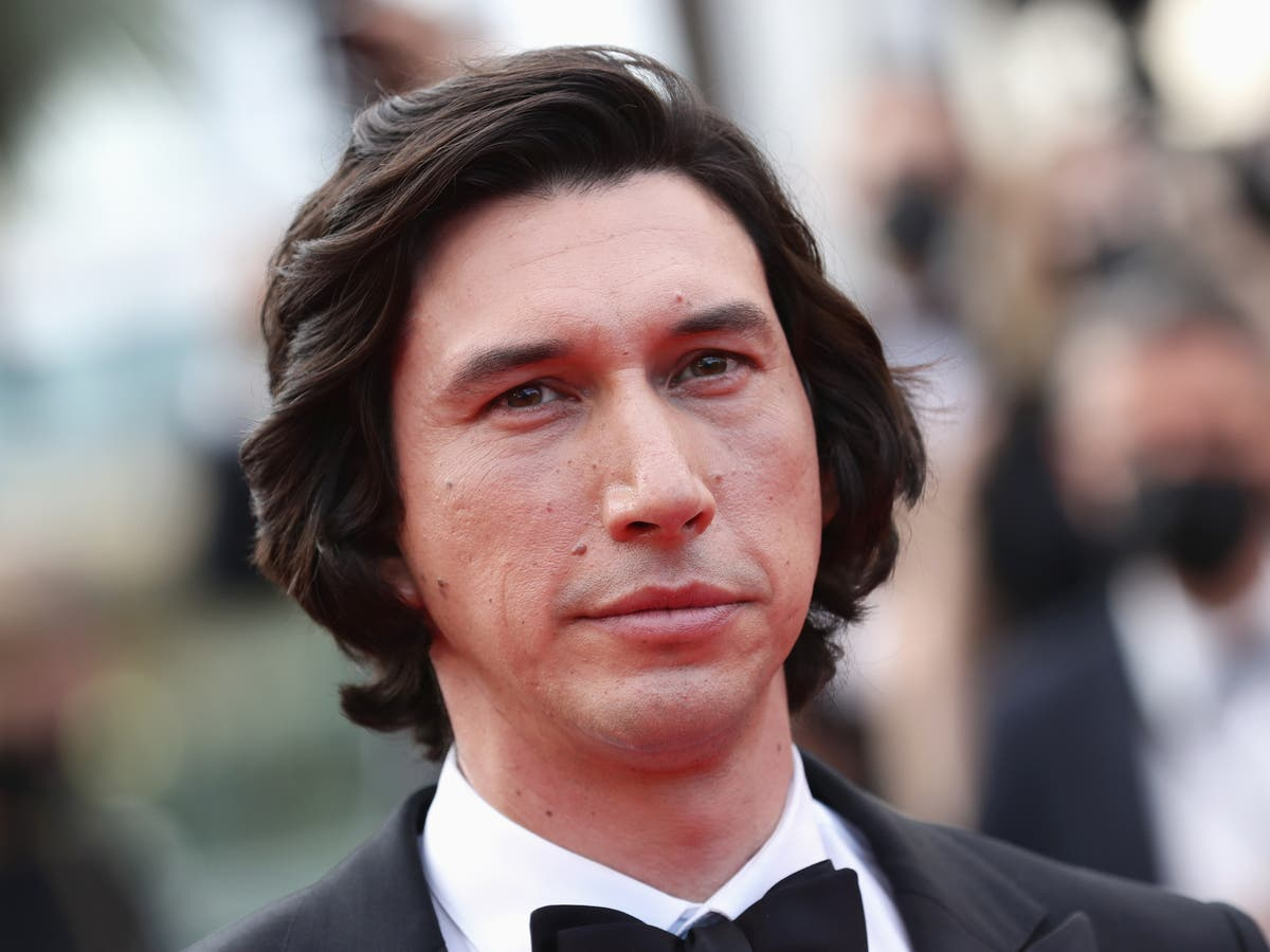 Adam Driver gets so bored during Cannes standing ovation he starts smoking a cigarette