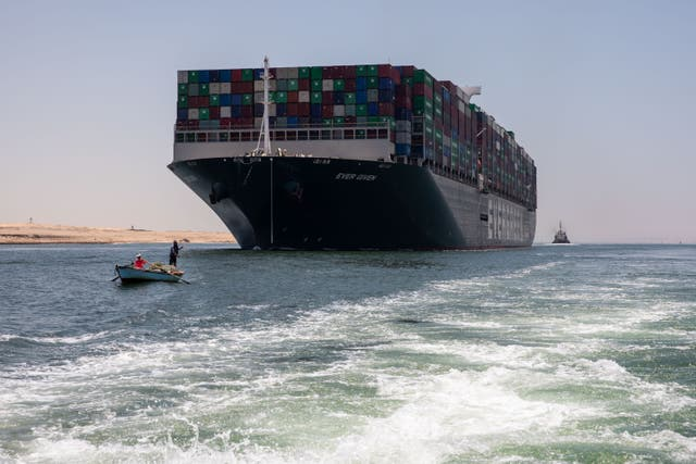 The Ever Given leaves the Suez Canal after its Japanese owners reached a settlement following more than three months and a court standoff over compensation for it blocking the crucial east-west waterway for nearly a week earlier this year
