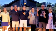 Michael Flynn's relatives deny using QAnon gesture in photo and claim it was a family 'statement of support' in CNN lawsuit