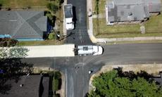 US cities trial 'sun block' on asphalt to slash city heat and break down harmful traffic pollution