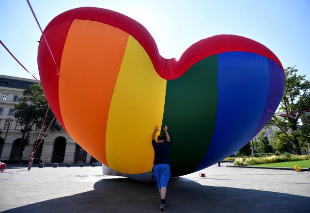 NGOs fly huge rainbow balloon at Hungary's parliament protesting against anti-LGBT law in Budapest