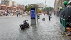 Storm Elsa: Passengers filmed wading through waist-high dirty water to get on New York subway after floods