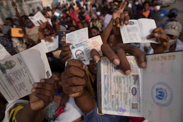 Hundreds of Haitians gather in front of the US embassy in the hope that they will be granted a visa to leave their country, due the uncertainty of what may happen after the assassination of President Jovenel Moise, in Port-au-Prince, Haiti