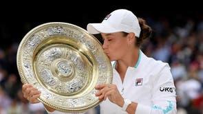 Australia's Ashleigh Barty holds the trophy after winning her final Wimbledon match against Czech Republic's Karolina Pliskova