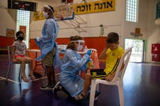 The Latest: Israel strikes Pfizer deal for new vaccine batch