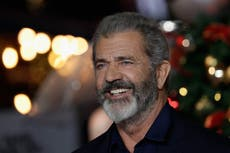 Video shows Mel Gibson giving Donald Trump a military-style salute at Conor McGregor's UFC match