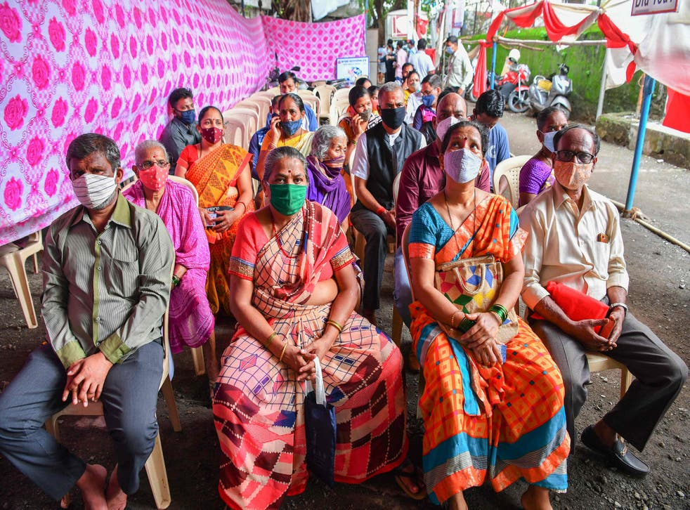 <p>People wait for the arrival of Covid-19 vaccine doses at a centre in India's Mumbai city on 12 July, 2021</p>