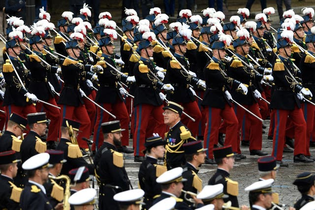 Pupils of the Special Military School of Saint-Cyr march during the annual Bastille Day military parade on the Champs-Elysees avenue in Paris