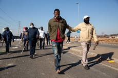 Vigilantes take to South Africa's streets as death toll from looting and violence rises to 72