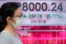 中国が成長の鈍化を報告しているため、アジアの株式取引はまちまち