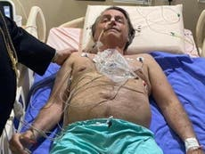 Jair Bolsonaro: president of Brazil remains in hospital but son says no need for surgery