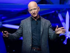 How much does Jeff Bezos make per minute?