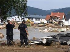 """德国-比利时洪水: 默克尔说德语中没有""""超现实""""破坏的词"""