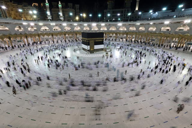 A long exposure photograph shows Muslim pilgrims circumambulating around the Kaaba, Islam's holiest shrine, at the Grand mosque in the holy Saudi city of Mecca during the annual hajj pilgrimage