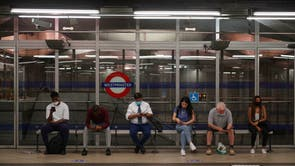 Commuters, some not wearing facemasks,  at Westminster Underground station, no 08:38 in London after the final legal Coronavirus restrictions were lifted in England