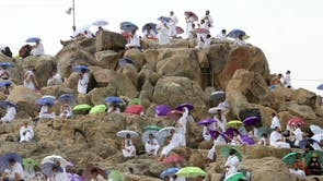 Muslim pilgrims gather on Mount Mercy on the plains of Arafat during the annual Haj pilgrimage outside the holy city of Mecca, Saudi Arabia