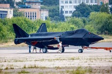 Russia unveils new fighter, Putin hails country's air power