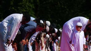 People during morning prayer during Eid ul-Adha, or Festival of Sacrifice, in Southall Park, Uxbridge, London