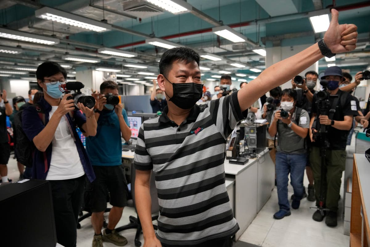 Hong Kong police arrest former senior editor of Apple Daily
