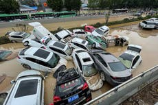 China flooding: Military blasts dam to divert flood water amid rescue for 1.2 million displaced