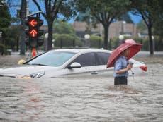 China floods - live: Military blasts dam to protect homes after heaviest rain in millennium kills dozens