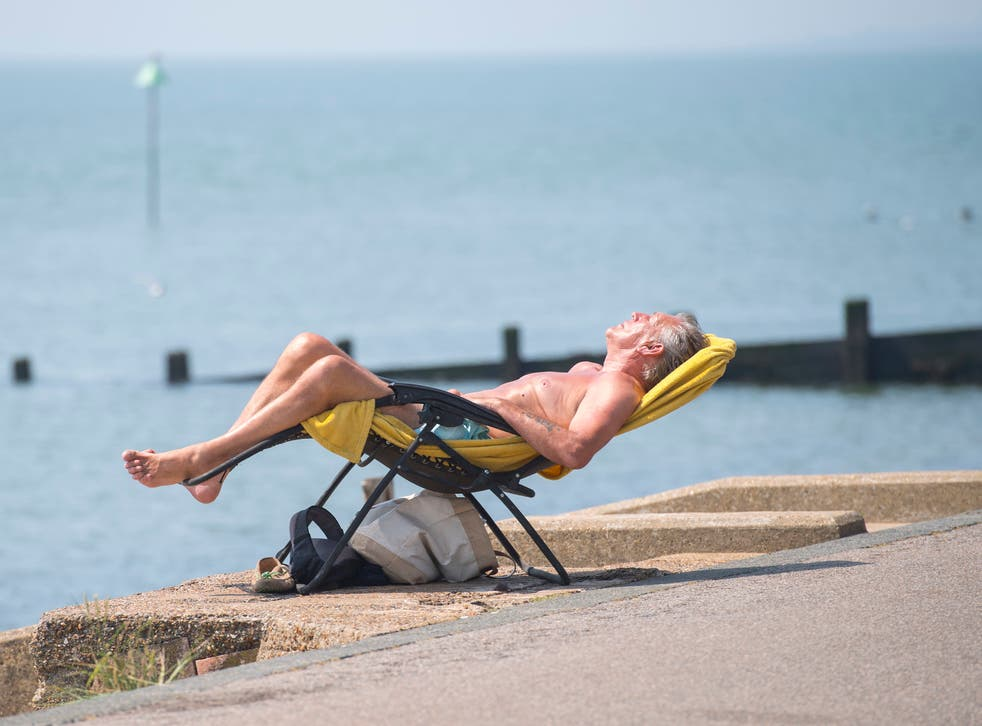 <p>People enjoy the sun on Southend beach in Essex during a UK heatwave</p>