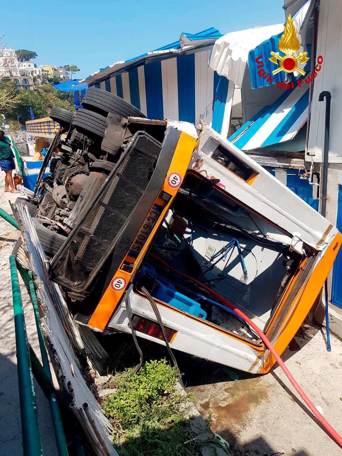 Bus plunges off road on Capri, lands near beach; driver dies