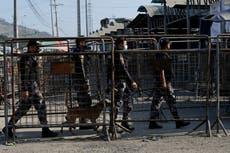 Fighting among prison gangs in Ecuador kills 18, dozens hurt